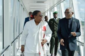H.E. President David Granger escorts Barbados Prime Minister Hon. Mia Mottley through the boarding bridge at CJIA