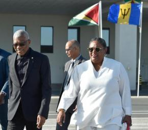 H.E. President David Granger escorts Barbados Prime Minister Hon. Mia Mottley following her arrival at CJIA