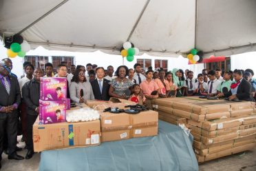 Diplomats, Members of the Guyana Table Tennis Association, Teachers and Students pose with some of the equipment donated