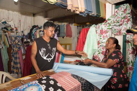 Ounkar Mohan serving a customer
