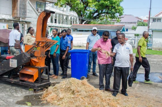 A satisfied Mayor Narine with the final product of the shredding machine.