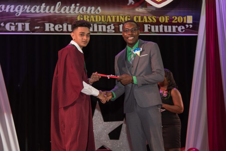 Valedictorian Feezal Dhanny receiving his certificate at the GTI 68TH Convocation ceremony
