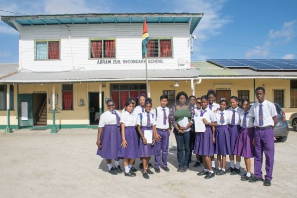 Coordinator of the Department of Governance at the Office of the Prime Minister (OPM), Tamara Khan with students of Abrams Zuil Secondary following her presentation.