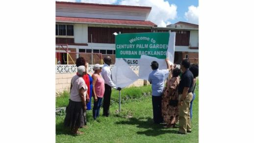 Mayor of Georgetown, Pandit Ubraj Narine, along with Commissioner of the Lands and Survey Commission, Trevor Benn and Councillors of the Mayor and City Council, unveiling a street marker at Durban Backlands.