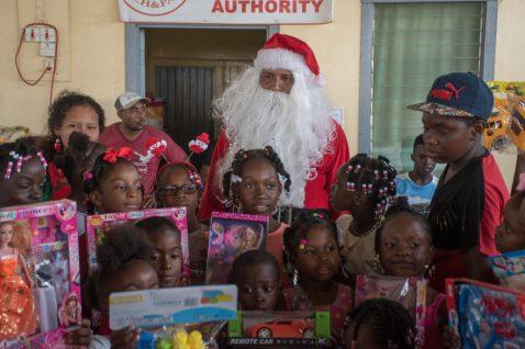 Kids posing with Santa