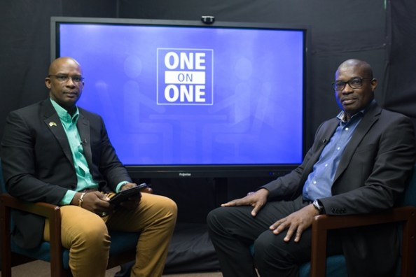 [L-R] Host of the One on One programme, Paul McAdam; Minister of Public Infrastructure, Hon. David Patterson
