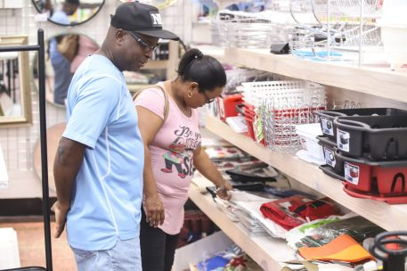 Elton Morna, with his wife, shopping for household items