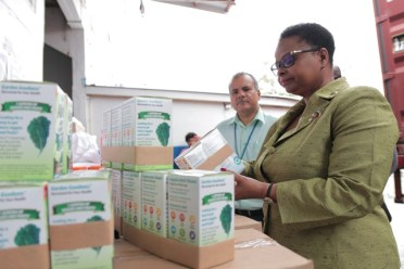 Minister Volda Lawrence examines some of the vitamins