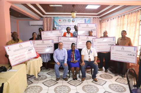 Recipients of UNDP's Micro-Grants. Also seated are UNDP Resident Representative, Jairo Valverde, Minister within the Ministry of Agriculture with responsibility for Rural Affairs, the Hon. Valerie Adams-Yearwood and Jason Chacon, Project Manager.