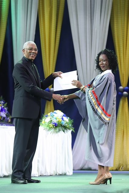 His Excellency, David Granger handing over the Presidential award for Best Graduating Student to the 2019 Valedictorian