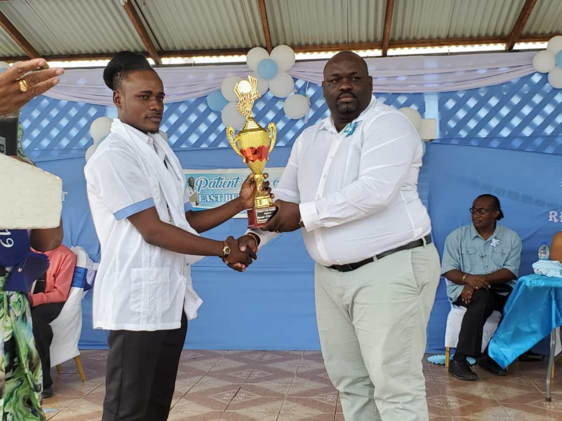 One of two valedictorians, Shawn Cameron receiving his award from Director of Regional Health Services Region Six, Jevaughn Andrew-Stephen