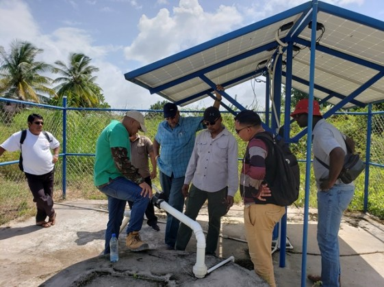 Dr. Van West-Charles and other GWI officials assess a water system in Apoteri.