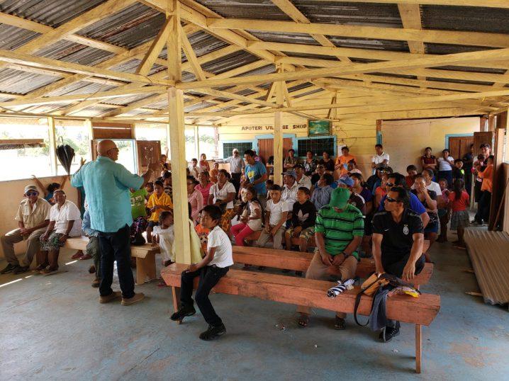 Dr. Richard Van West-Charles addresses residents of Apoteri