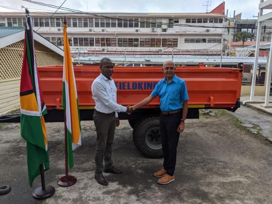 Minister of Communities Ronald Bulkan hands over trailers to Mayor of Bartica, His Worship Gifford Marshall