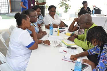 Staff of the Palms Geriatric Home meet with officials of the Ministry of Public Health.