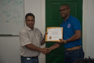 Trinidad-based Business Crisis consultant, Garth Vincent presenting a certificate to one of the participants.
