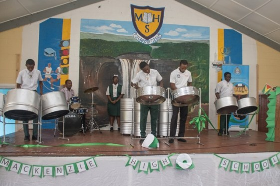 Members of the Mackenzie High School's Steel Orchestra performing a rendition.