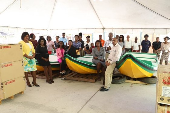 Minister of Public Health Volda Lawrence, Director of Regional and Clinical Services, Dr. Kay Shako showcasing three of the boats with staff of the Public Health Ministry.