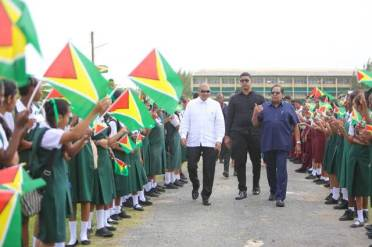 Students of Region two welcome Prime Minister the Hon. Moses Nagamootoo and Minister of Business Hon. Haimraj Rajkumar.