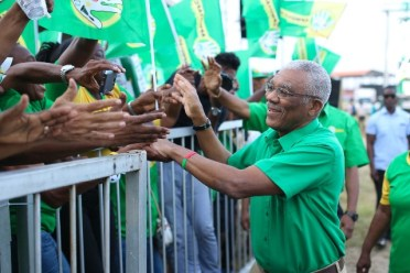H.E. President David Granger is greeted by hundreds of supporters at the Leonora Track and Field ground, in Region Three.