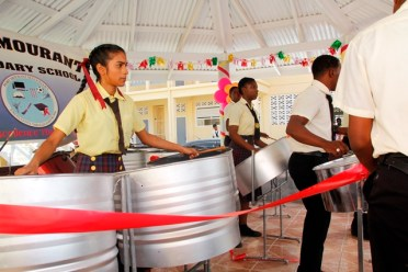 Students of the Port Mourant Secondary School playing their new steelpans.