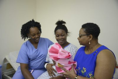 Minister of Public Health, Volda Lawrence with Shanice McPherson, her baby Majesty and the mid-wife that delivered the baby