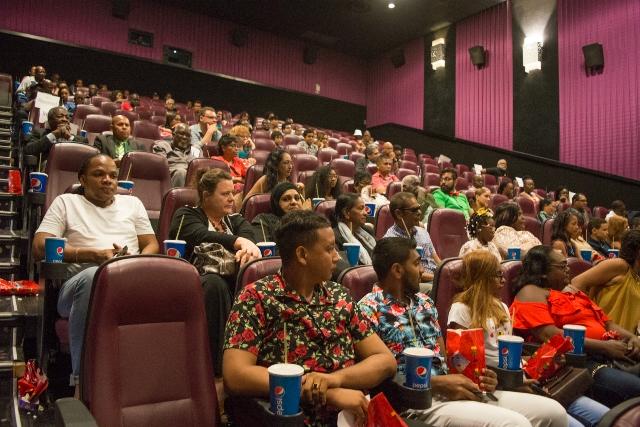 Onlookers and actors enjoying the film.