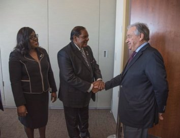 Mr. Antonio Gutteres, UNSG greeting Hon Prime Minister as Min. Cummings looks on.