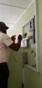 The technician inspecting the solar electrical work.