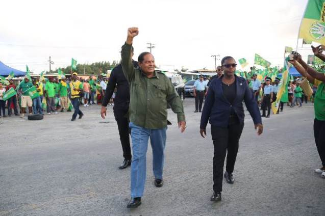 Prime Minister the Hon. Moses Nagamotoo salutes the crowd as he arrives for the rally at Damon Square, Anna Regina.