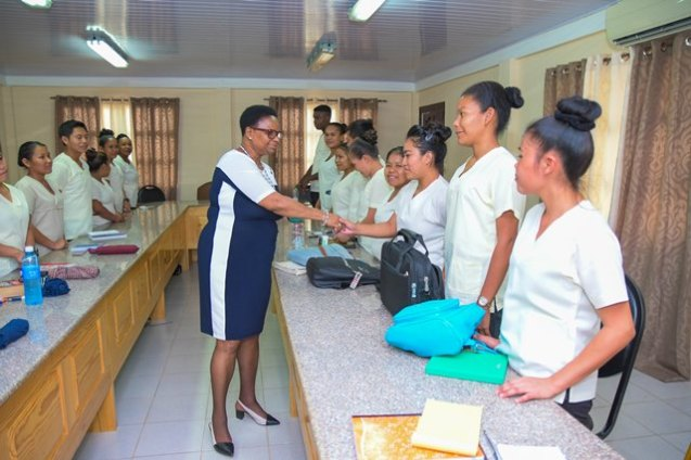 Minister Lawrence greets the Community Health Workers.