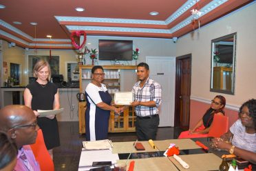 Dr. Julian Clementson, Deputy Regional Health Officer, Cuyuni-Mazaruni receives his certificate from Minister Lawrence after completing his CT competency training