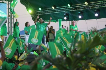 HE President David Granger, First Lady Mrs. Sandra Granger, acknowledge the supporters as they arrive on stage.