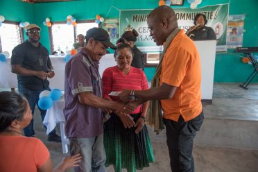 Lelon Saul handing over the keys to the beneficiaries of the new homes in Sand Creek, Region Nine