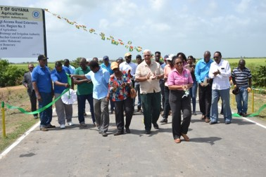 Minister of Agriculture Noel Holder (centre) along with staff of the Ministry at the commissioning of the road.