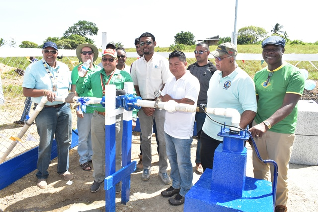 Minister of Indigenous Peoples' Affairs, Hon. Sydney Allicock, GWI's Managing Director, Dr. Richard Van West-Charles, Aishalton Toshao, Mr. Michael Thomas and other officials at the well site.