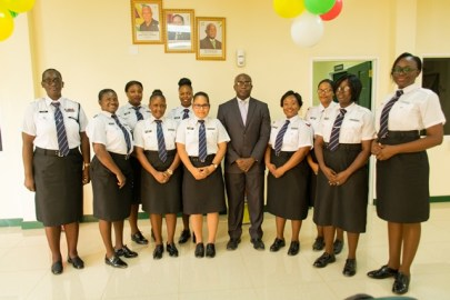 Immigration Officers at the Immigration and Passport Office in Region 10 and Deputy Chief Immigration Officer Superintendent Ewart Wray (centre with jacket).