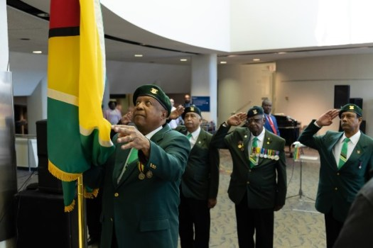 Veterans of the Guyana Defence Force hoisting the Golden Arrowhead at the Toronto Republic Day flag raising and interfaith ceremony.