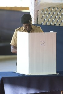 An officer of the GPF casting his ballot.