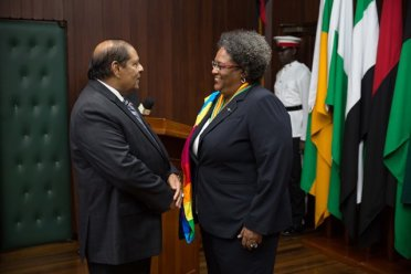 Prime Minister the Hon. Moses Nagamootoo chats with Hon. Mia Amor Mottley Prime Minister of Barbados.