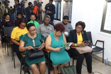 Government ministers read through the manifesto at the launch.