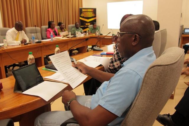 A participant reviews material on non-conforming trade measures (NCMs).