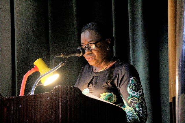 Minister Henry delivering remarks.