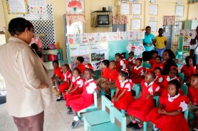 Regional Education Officer, Mrs. La Cruz speaking to students of the Hibiscus Nursery School.