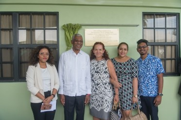 President David Granger [Second from Left] with members of Campbell's family.