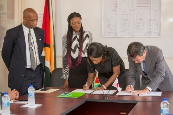 - His Excellency Tatsuo Hirayama, Ambassador of Japan to Guyana and Chief Executive Officer (CEO) of the VYC, Goldie Scott signing the document during the ceremony on Friday.