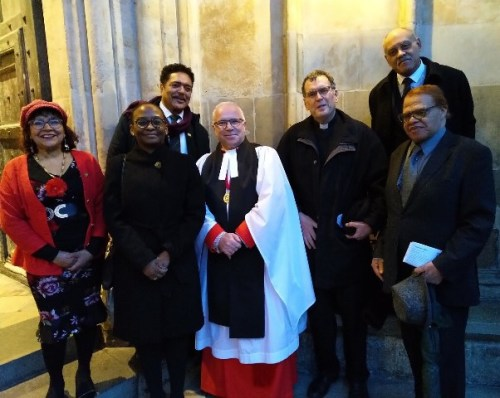 Acting High Commissioner, Peggy McLennan and the Dean of Westminster Abbey, David Hoyle (center) with members of the diaspora on the steps of Westminster Abbey.