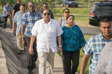 Prime Minister, Hon. Moses Nagamootoo and wife, Sita Nagamootoo arriving at the National Aquatic Center to cast their votes on Monday morning.