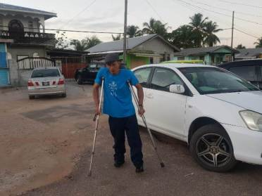 Perseverance: Disabled, injured and elderly persons voting at the various polling stations.
