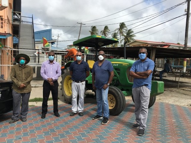 Mayor of Rose Hall Town Chattergoon Ramnauth (left) with members of the Central Corentyne Chambers at the commencement of the sanitisation exercise